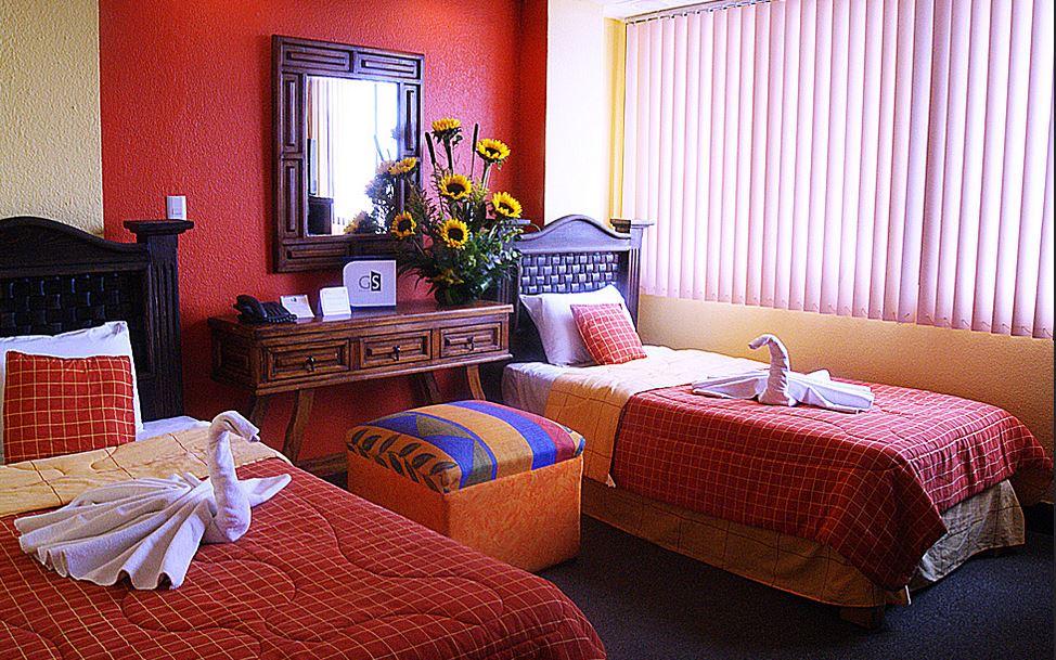 compartir habitacion con 2 camas separadas