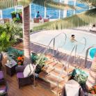 vacaciones_singles_cruceros_para_solteros_en_harmony_of_yhe_seas_solarium.jpg?itok=wWkFkp4t
